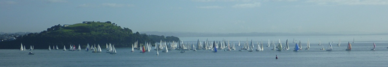 Due to light winds and an incoming tide, despite the staggered start, the boats remained close together rounding North Head